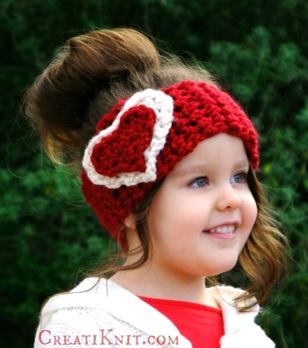 Cupid head warmer free crochet and knit pattern. Part of a free crochet roundup for Valentine's day by mallooknits.com