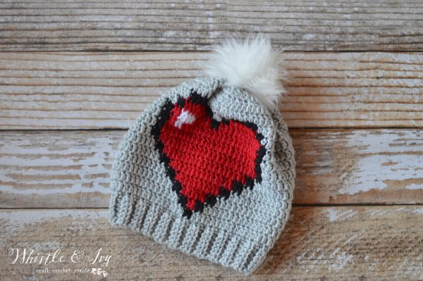 Crochet 8-bit heart slouchy hat. Part of a free crochet roundup for Valentine's day on mallooknits.com.