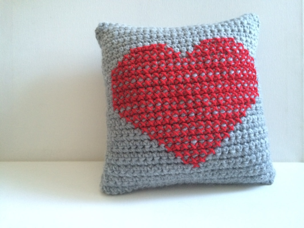 Crochet heart pillow with a little embroidery. Part of a free crochet pattern roundup for Valentine's day on mallooknits.com