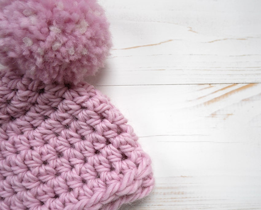 Crochet newborn hat with pom pom photo tutorial.