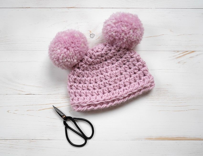 Crochet newborn hat with pom poms for beginners.