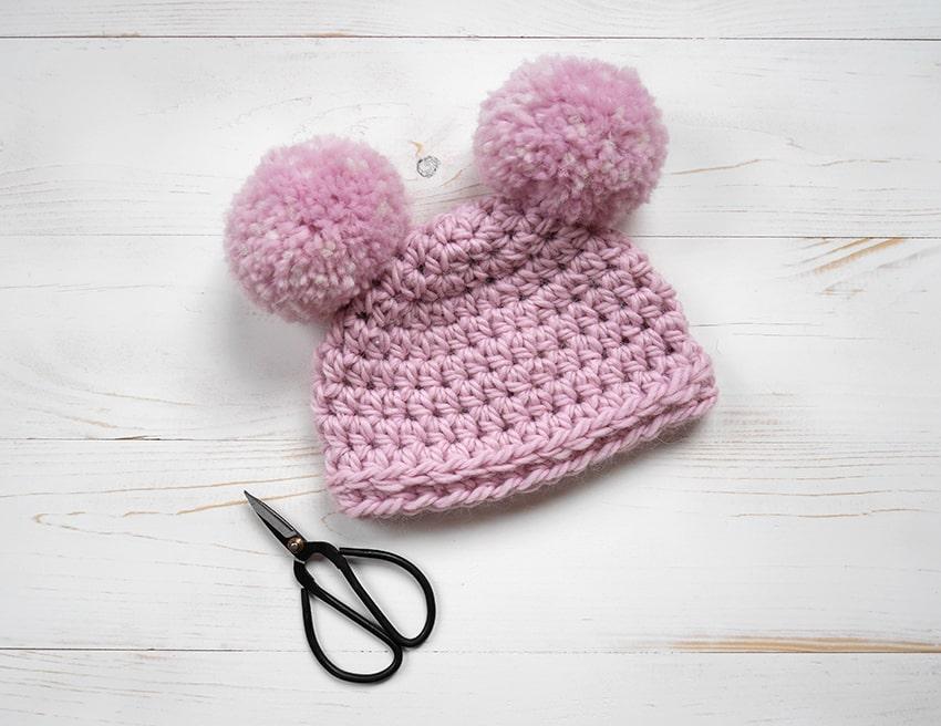 Crochet newborn hat with pom poms for beginners.