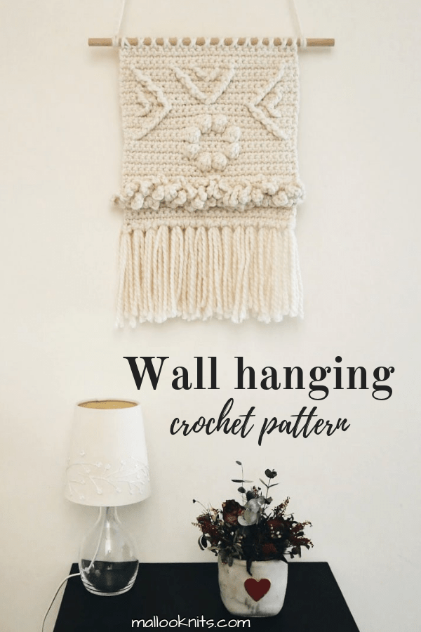 Do you love woven wall hangings but just know how to crochet? Use this crochet wall hanging pattern to make one for your home. #crochetwallhanging #crochetwalldecor