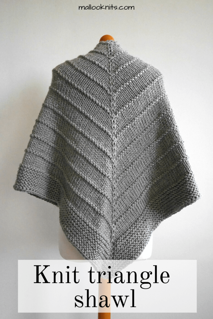 Easy knit triangle shawl pattern. Made with super bulky yarn this knit triangle wrap will fly off your needles. The pattern is easy to memorise and can be completed by the confident beginner. #knittriangleshawl #knittedtrianglewrap #trianglescarfpattern